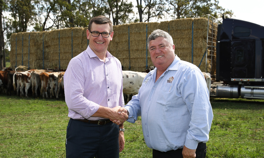 David Clancy, NSW General Manager - Cleanaway Waste Management (L), and Charles Alder, Founder, Rural Aid (R) attend an announcement of donation of $70,038 from the Return and Earn scheme to the Buy a Bale charity in Werombi, NSW, on Monday, December 17, 2018. (AAP Image/Brendon Thorne)